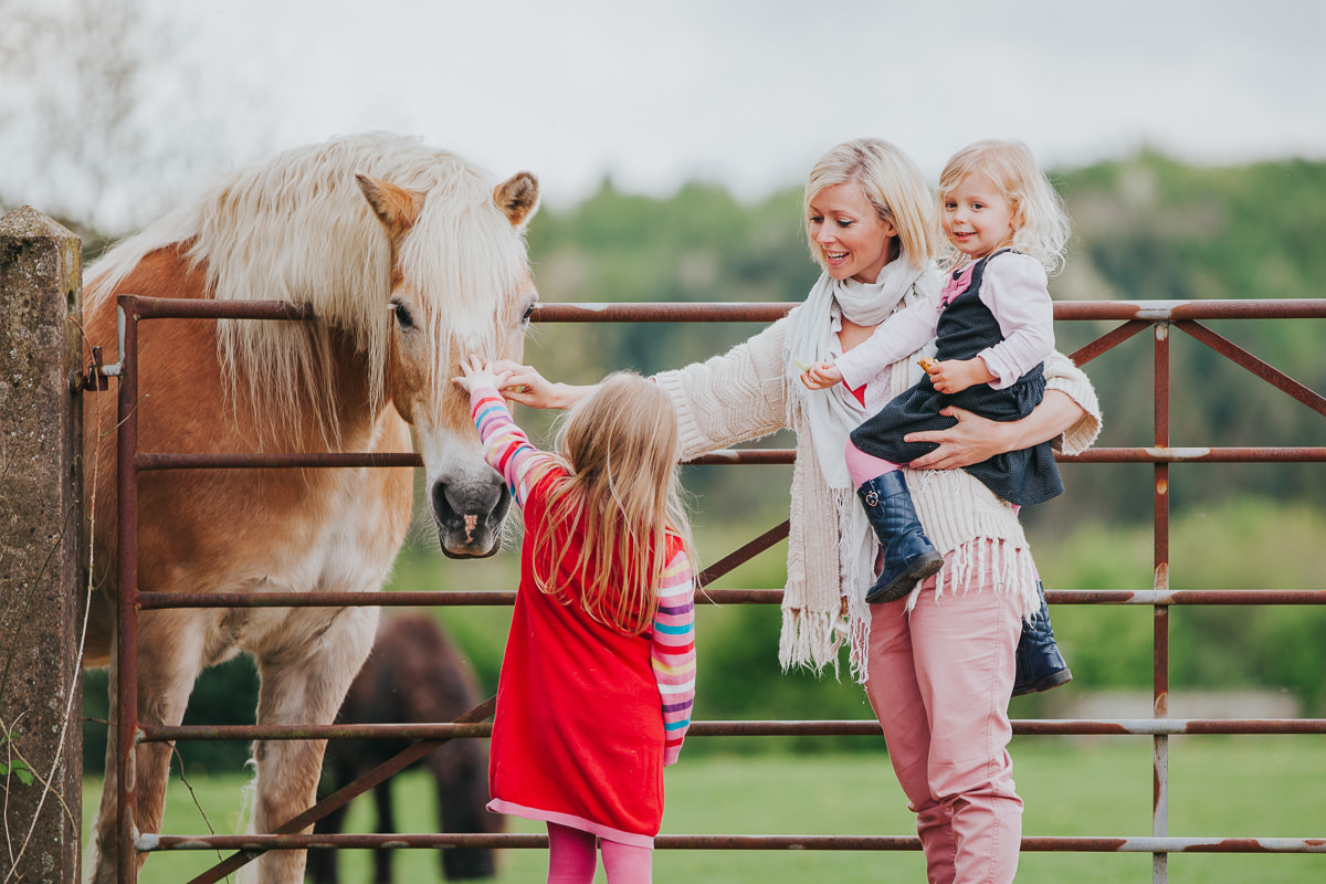 autumnal documentary family photo with horse