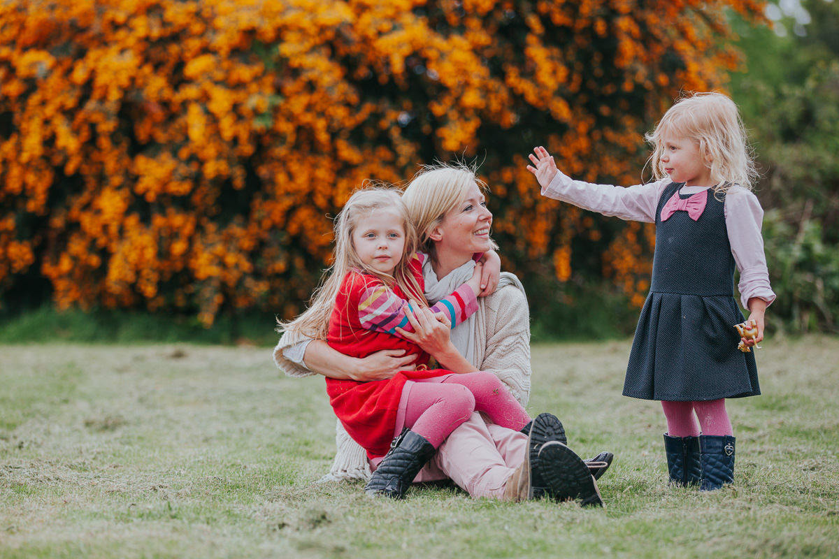 autumnal portrait of mother and daughters