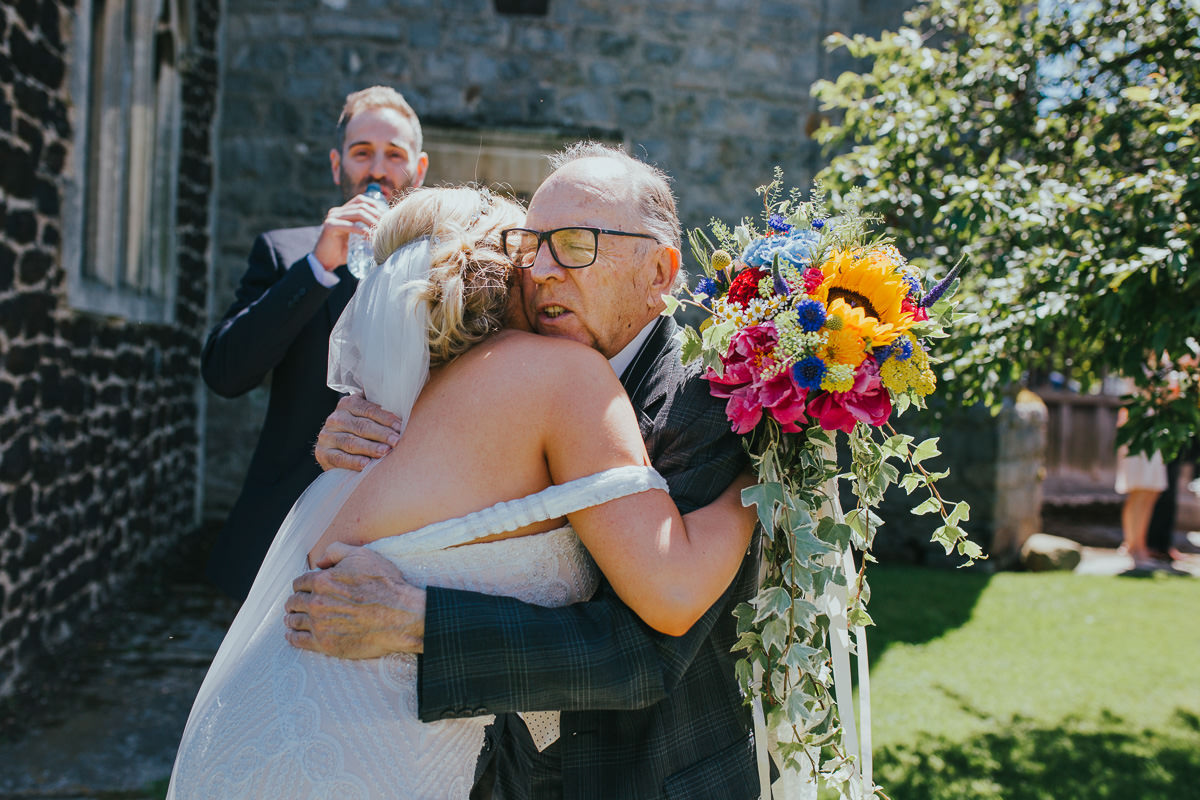 bride hugging grandfather