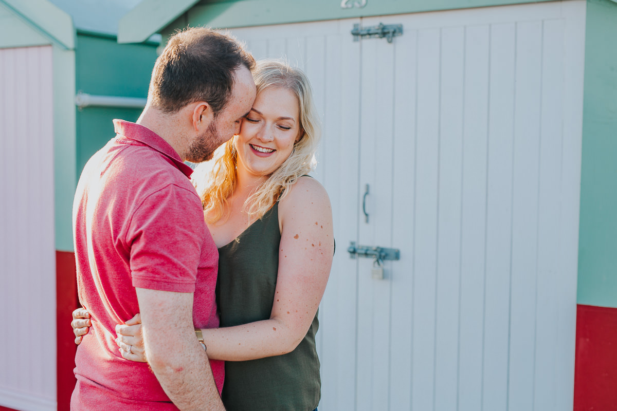couple photo by beach huts