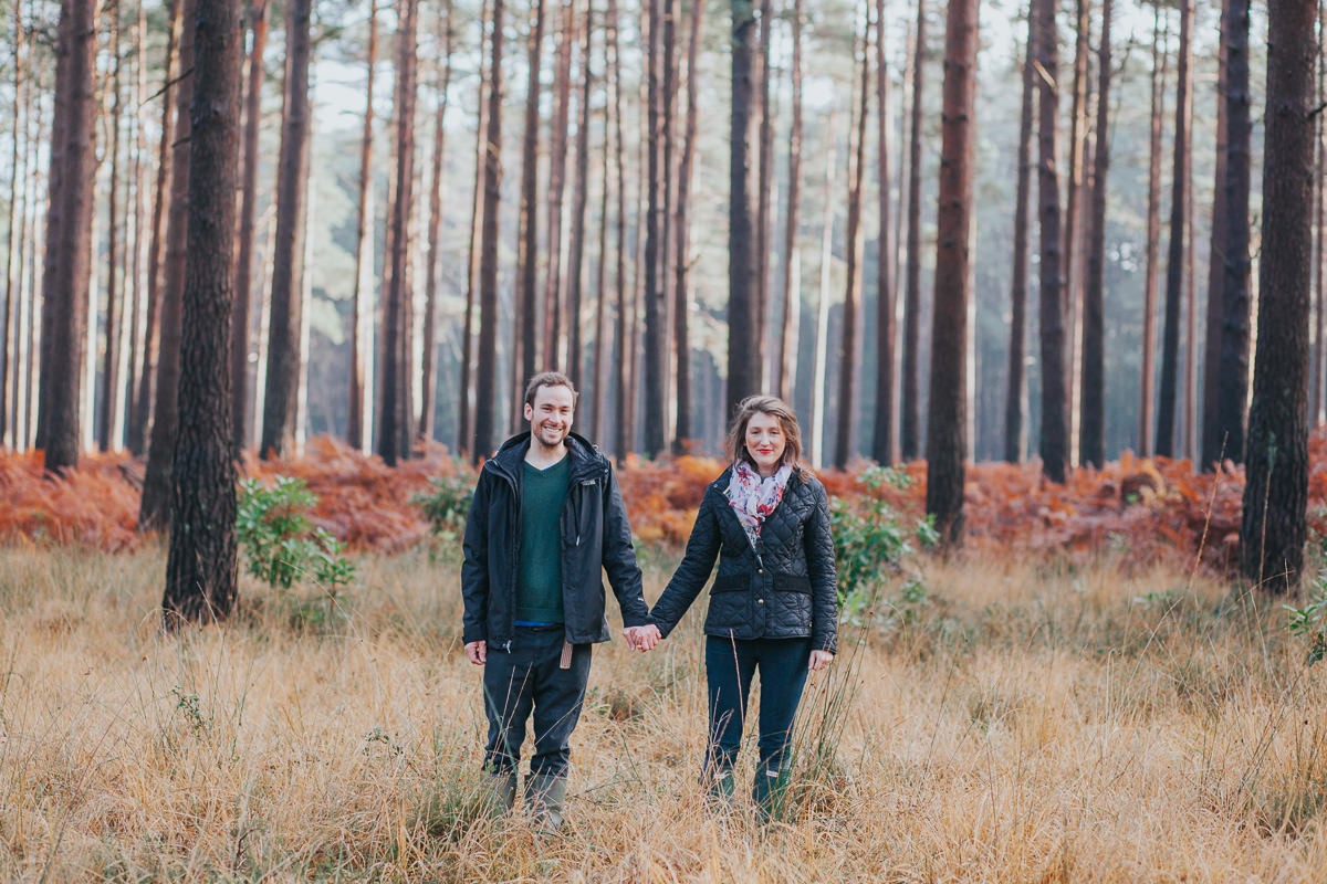 couple photo holding hands in woods