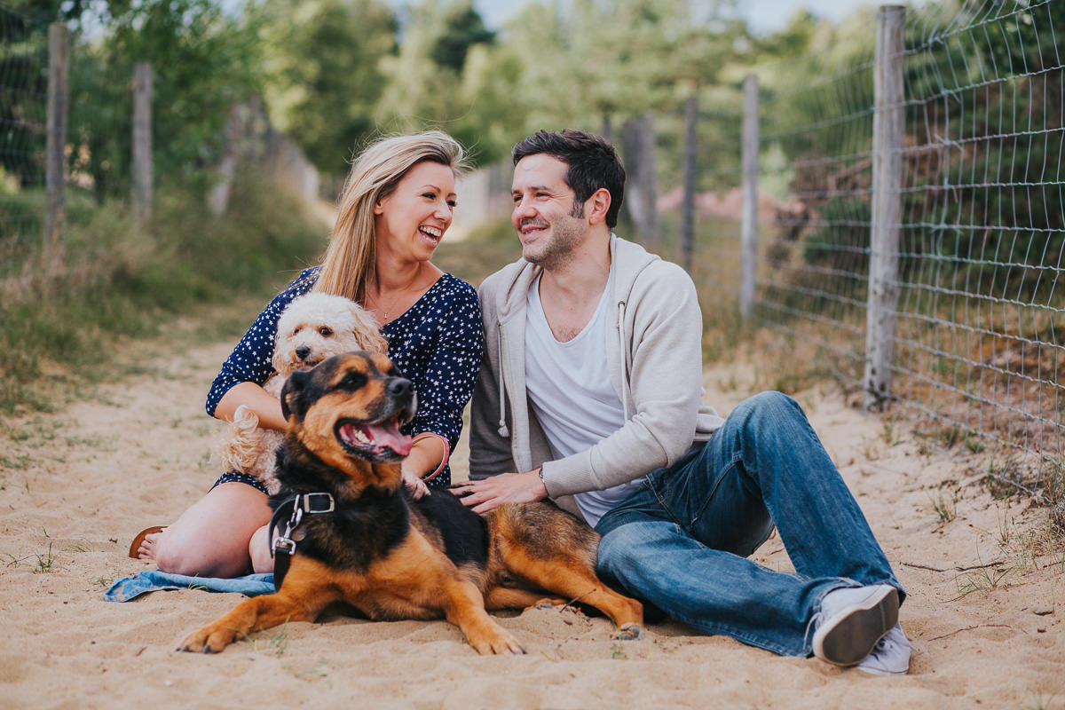 couple photo with dogs