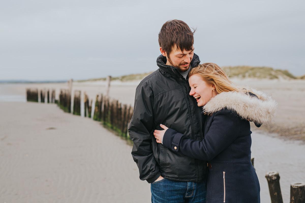 fun couple photo at beach