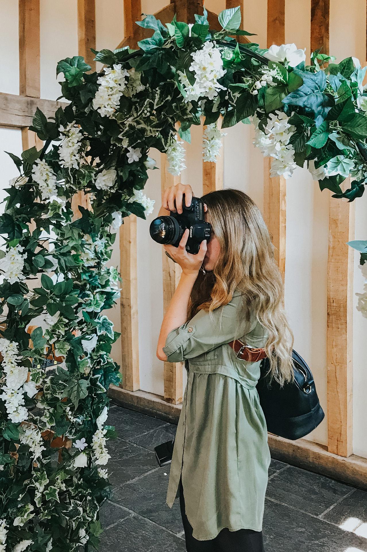 photographer working on wedding day
