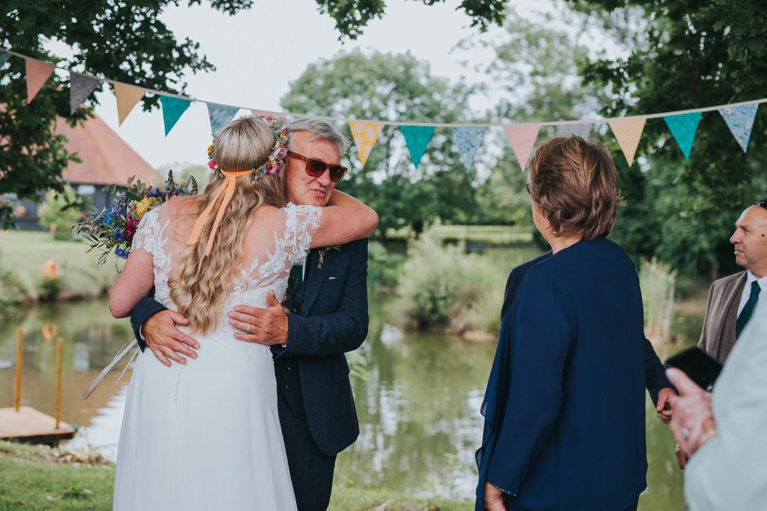 guests hugging at outdoor wedding