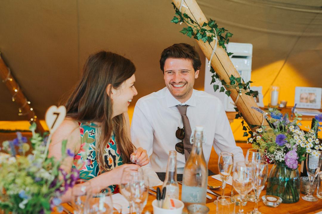 guests enjoying tipi wedding